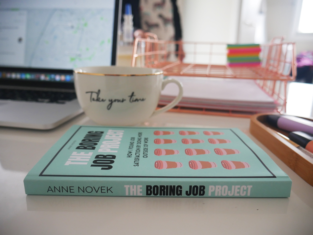 the boring job project book with cup of tea
