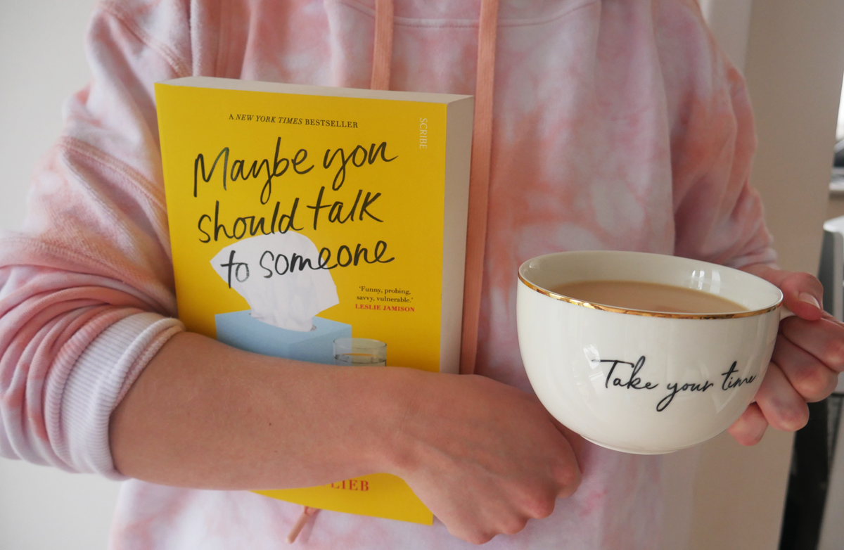 maybe you should talk to someone paperback by lori gottlieb and cup of tea in pink jumper